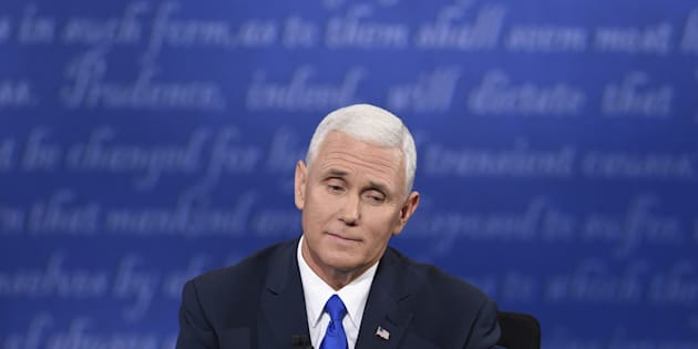 Republican vice presidential candidate Mike Pence looks on during the US vice presidential debate at Longwood University in Farmville, Virginia on October 4, 2016.    / AFP / SAUL LOEB        (Photo credit should read SAUL LOEB/AFP/Getty Images)