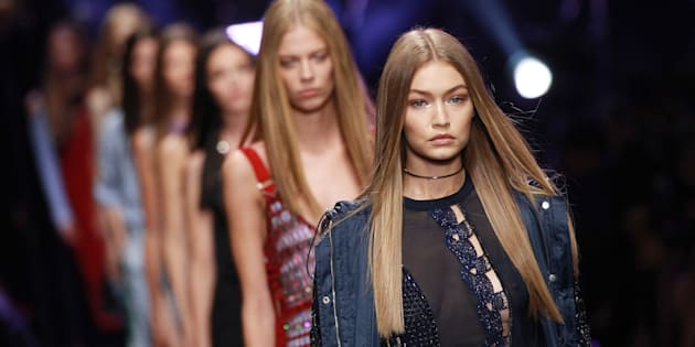 Gigi Hadid walks the runway at the Versace show during Milan Fashion Week.