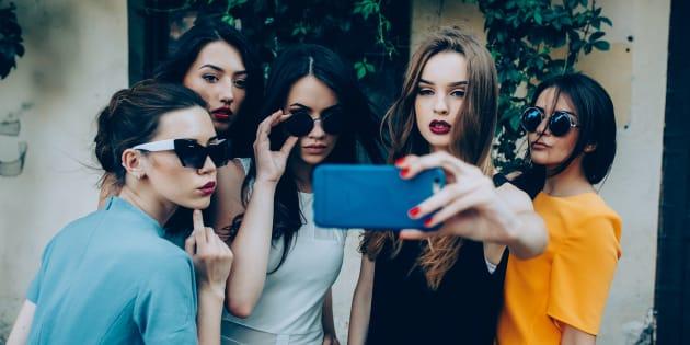 Girls taking a selfie.