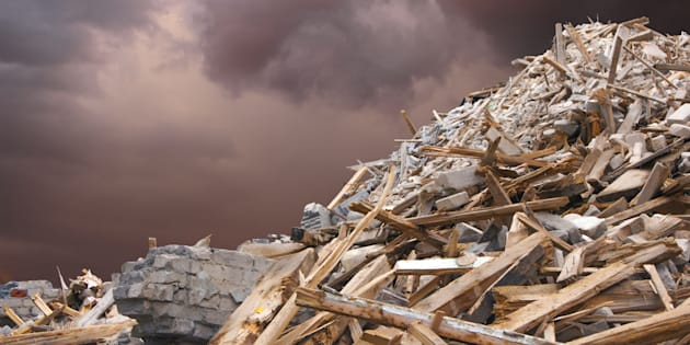 Destroyed building and debris after a strong wind.