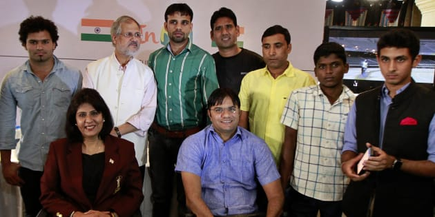 Delhi Lieutenant Governor Najeeb Jung with Para-athletes during the launch of 'InRio' app for Rio 2016 Paralympics Games on September 2, 2015 in New Delhi, India.