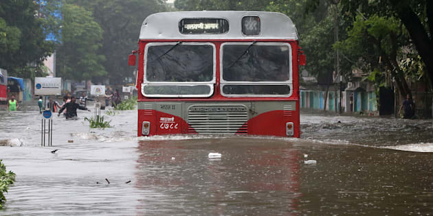 A passenger bus moves through a water-logged road during rains in Mumbai, India, August 29, 2017. REUTERS/Shailesh Andrade