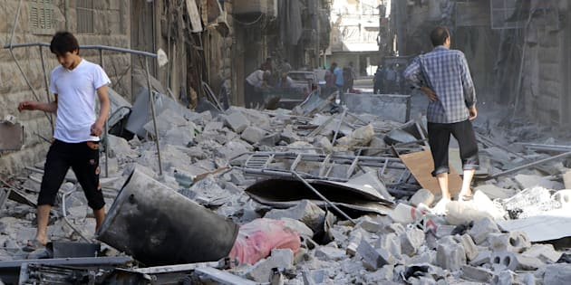ALEPPO, SYRIA - SEPTEMBER 24: People inspect the debris of buildings after Syrian and Russian army carried out an airstrike on a residential area at Bustan Al-Qasr neighborhood of Aleppo, Syria on September 24, 2016. It is reported that 56 people were killed 220 people wounded after the attack.          (Photo by Ibrahim Ebu Leys/Anadolu Agency/Getty Images)