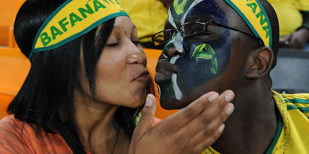 Fans kissing during a soccer match at Soccer City.