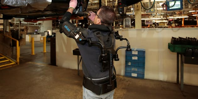 Ford assembly worker Paul Collins wears an EksoVest as he works on the assembly line producing the Ford Focus and C-max at Wayne Assembly plant in Wayne, Michigan.
