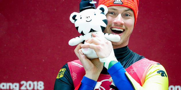 PYEONGCHANG, SOUTH KOREA  FEBRUARY 11, 2018: Luger Johannes Ludwig of Germany holds a plush toy of the PyeongChang 2018 Olympics mascot Soohorang as they pose at the flower ceremony for the men's singles luge event at the 2018 Winter Olympic Games, at the Olympic Sliding Centre. Sergei Bobylev/TASS (Photo by Sergei Bobylev\TASS via Getty Images)