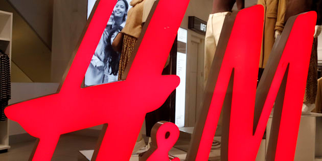 The logo of H&M is seen in a display window of a store in Zurich, Switzerland January 7, 2019. Picture taken January 7, 2019.  REUTERS/Arnd Wiegmann