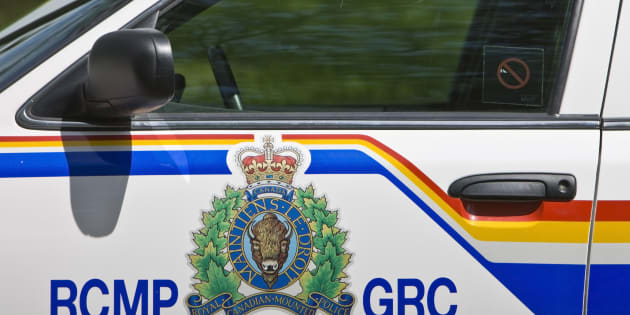 A RCMP officer rescued a car crash victim by stopping a moving train.