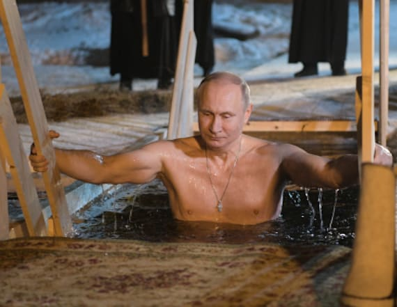 Vladimir Putin takes half-naked dip in icy lake