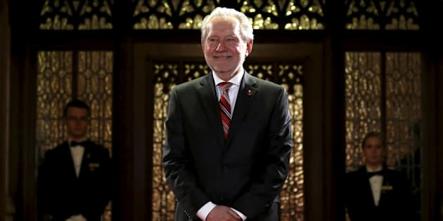 Peter Harder poses in the entrance of the Senate chamber on April 12, 2016.