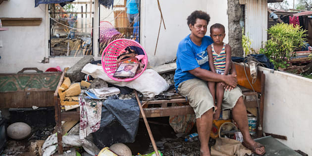 Kalisi holds her son Tuvosa, 3, in the remnants of her house in Rakiraki District in Ra province on February 24, 2016 in Fiji. Category 5 Tropical Cyclone Winston made landfall in Fiji on Saturday 20 February, continuing its path of destruction into Sunday 21 February.