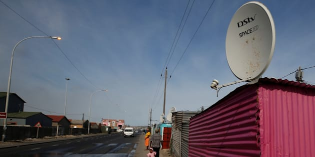 A satellite dish connecting residents to South Africa's DSTV television network, owned by telecommunications giant Naspers, adorns a shack in Khayelitsha township, Cape Town, May 25, 2017.
