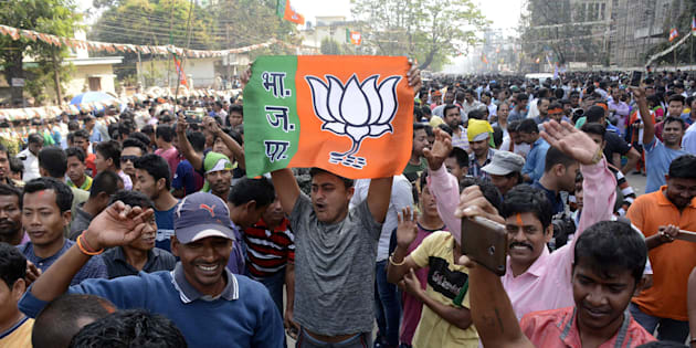 Indian supporters of the Bharatiya Janata Party (BJP) celebrates at a rally as voting was underway for the Tripura legislative assembly election in Agartala, the capital of the northeastern state of Tripura, on March 3, 2018.