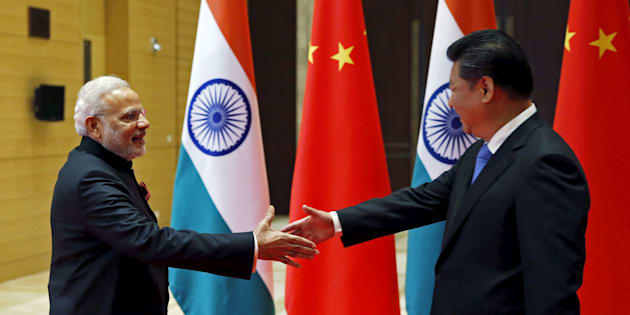 Indian Prime Minister Narendra Modi (L) and Chinese President Xi Jinping shake hands before they hold a meeting in Xian, Shaanxi province, China, May 14, 2015.  REUTERS/Kim Kyung-Hoon