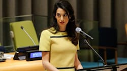 No, Amal Clooney Wasn't 'Showing Off Her Baby Bump' At The