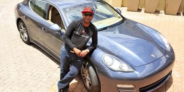 Millionaire Kenny Kunene shows off his Porsche Panamera on in Johannesburg. Photo by Lucky Maibi/Foto24/Gallo Images/Getty Images