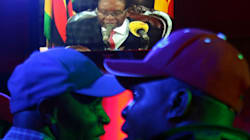 President Mugabe Stuns Zimbabwe By Defying Pressure To