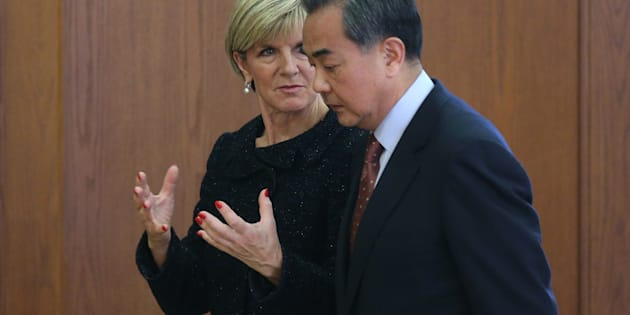 Chinese Foreign Minister Wang Yi (R) and Australian Foreign Minister Julie Bishop talk after a joint press conference at the Ministry of Foreign Affairs in February last year.