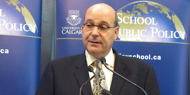 Jack Mintz of the School of Public Policy at the University of Calgary speaks to reporters in Calgary on Sept. 24, 2013.