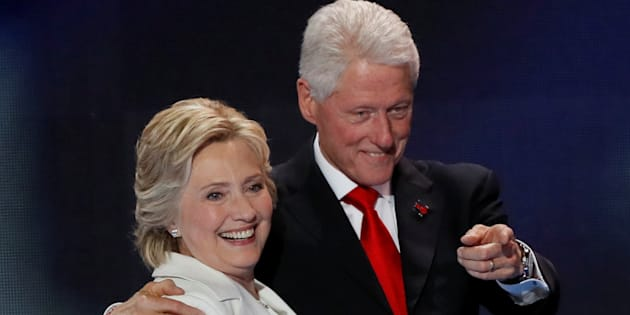 U.S. Democratic presidential nominee Hillary Clinton stands with her husband, former President Bill Clinton.