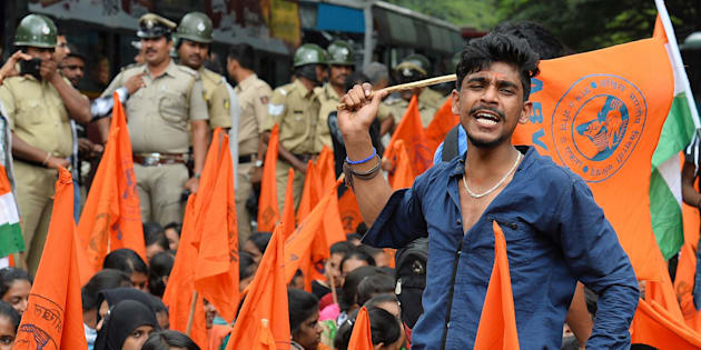 Muslim students and activists of the ABVP raise slogans against anti-national forces during a protest in Bangalore on August 17, 2016.