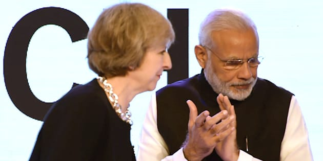 File photo of Britain's Prime Minister Theresa May (L) and Indian Prime Minister Narendra Modi.
