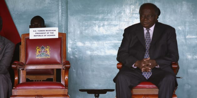 Former president Mwai Kibaki sits on the presidential chair during a Cabinet swearing-in ceremony in Nairobi in April 2008.