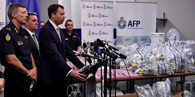 Justice Minister Michael Keenan at a press conference during a presentation of seized crystal methamphetamine concealed in packaging at the Australian Federal Police headquarters in Sydney on February 15, 2016.
