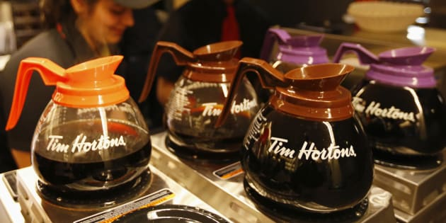 Tim Hortons employees prepare coffee before the company's annual general meeting in Toronto on May 8, 2014.