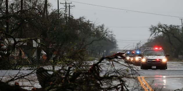 A fallen tree lies along a road as an emergency response team arrives to assess damage from Hurricane Harvey in Rockport, Texas, U.S. August 26, 2017. REUTERS/Adrees Latif