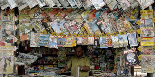 A vendor works at a stall at a railway platform in Mumbai May 1, 2008.