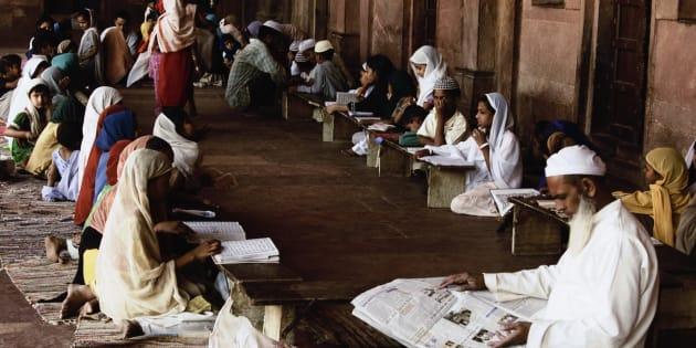 Students studying in madrasa, Agra, Uttar Pradesh, India. (Photo by: Exotica.im/UIG via Getty Images)