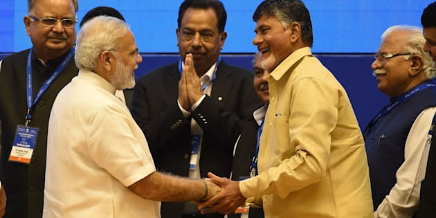 Prime Minister Narendra Modi (2L) shakes hands with Chief Minister of Andhra Pradesh state Chandrababu Naidu (2R) on 30 September 2016. PRAKASH SINGH/AFP/Getty Images