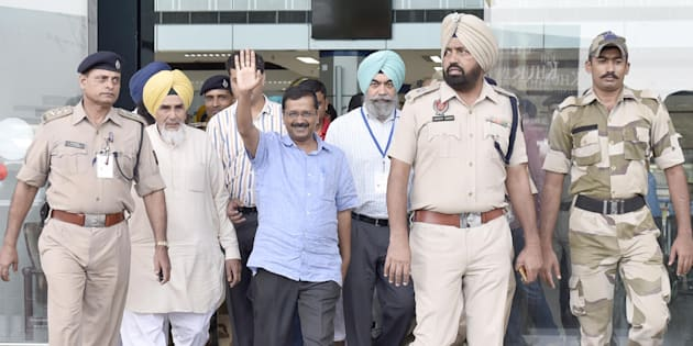 AMRITSAR, INDIA - JULY 17: Delhi CM Arvind Kejriwal waving towards party workers after reaching airport on July 17, 2016 in Amritsar, India.