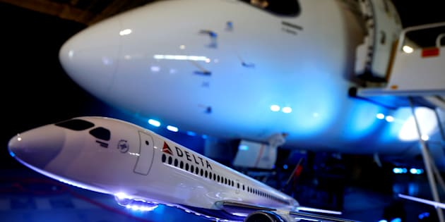 A model of a Delta airplane sits in front of the Bombardier CS100 aircraft after a news conference announcing a contract with Delta Air Lines, at Bombardier's hangar in Mirabel, Que. on April 28, 2016.
