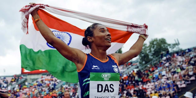 Athletics - 2018 IAAF World U20 Championships ? women's 400 metres ? Tampere, Finland ? July 12, 2018. Hima Das of India celebrates her victory. Lehtikuva/Kalle Parkkinen via REUTERS ATTENTION EDITORS - THIS IMAGE WAS PROVIDED BY A THIRD PARTY. NO THIRD PARTY SALES. NOT FOR USE BY REUTERS THIRD PARTY DISTRIBUTORS. FINLAND OUT. NO COMMERCIAL OR EDITORIAL SALES IN FINLAND.
