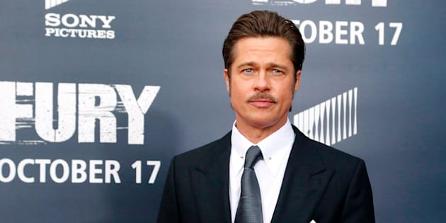 """Cast member Brad Pitt arrives on the red carpet at the premiere of World War II film """"Fury"""" at the Newseum in Washington October 15, 2014.  REUTERS/Jonathan Ernst    (UNITED STATES - Tags: ENTERTAINMENT)"""