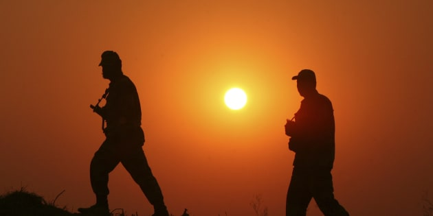File photo of Indian Border Security Force (BSF) soldiers as they patrol the fenced border with Pakistan at Babiya village in Hira Nagar sector, about 80 km (50 miles) from Jammu December 6, 2013.