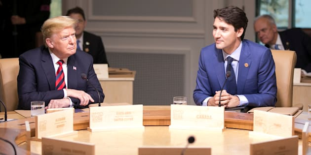 U.S. President Donald Trump and Prime Minister Justin Trudeau participate in the working session at the G7 Summit in La Malbaie, Que. on June 8, 2018.