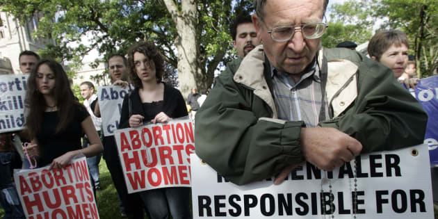 Anti-abortion activists demonstrated outside Western University in London, Ont. to protest Dr. Henry Morgentaler's honorary degree on June 16, 2017.