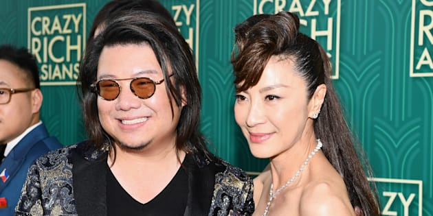 Author Kevin Kwan poses with actor Michelle Yeoh at the 'Crazy Rich Asians' Premiere at TCL Chinese Theatre on August 7, 2018.)