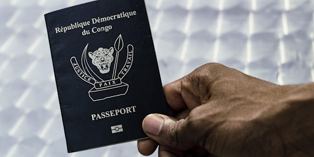 An immigration official displays a Congolese biometric passport in the Democratic Republic of Congo's capital Kinshasa, February 10, 2017.  Picture taken February 10, 2017.