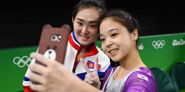South Korea's Lee Eun Ju and North Korean gymnast Hong Un Jong take a selfie.