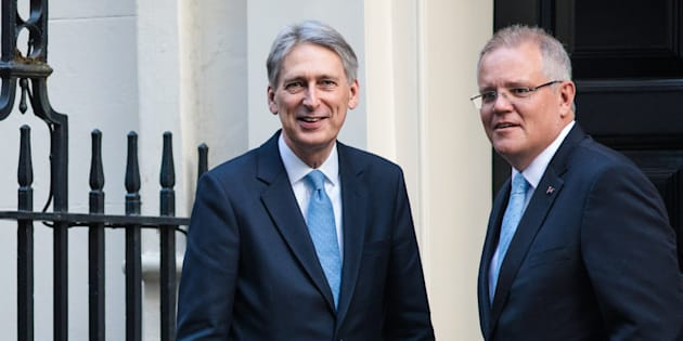 LONDON, ENGLAND - JANUARY 24: British Chancellor of the Exchequer Philip Hammond greets  Scott Morrison (R) outside Number 11 Downing Street on January 24, 2017.