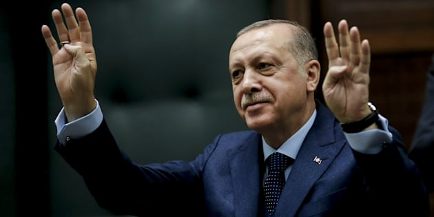 ANKARA, TURKEY - JANUARY 30: President of Turkey and Leader of the Justice and Development Party (AK Party) Recep Tayyip Erdogan greets members of AK Party during his party's group meeting at the Grand National Assembly of Turkey (TBMM) in Ankara, Turkey on January 30, 2018. (Photo by Fatih Aktas/Anadolu Agency/Getty Images)