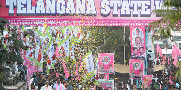 File photo of Telangana Rashtra Samiti (TRS) party president K. Chandrasekhar Rao and other officials riding on a truck during a victory procession for the formation of a separate Telangana state in Hyderabad on February 26, 2014.