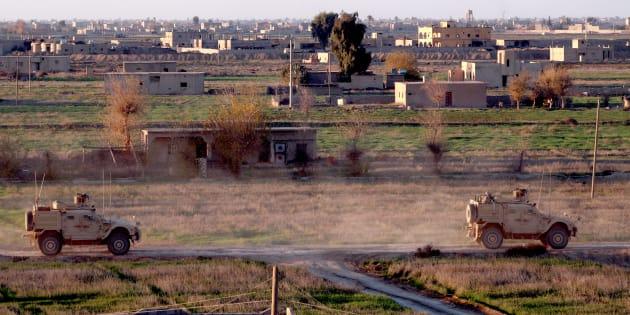 Des véhicules de l'armée américaine dans la province de Deir Ezzor dans l'est de la Syrie le 15 décembre 2018.