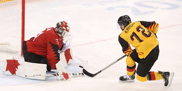 Kevin Poulin of Canada stops a penalty shot by Dominik Kahun of Germany during the Men's Play-offs Semifinals at the PyeongChang Winter Olympic Games on Friday in Gangneung, South Korea.