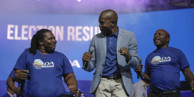 DA leader Mmusi Maimane dances with other party members during the closing of the federal congress in Pretoria on April 8 2018.