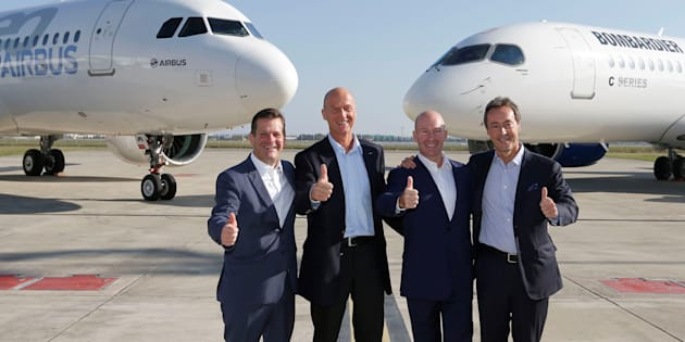 (L-R) Pierre Baudoin, Bombardier's chairman of the board, Tom Enders, president and chief executive officer of Airbus, Alain Bellemare, president and chief executive officer of Bombardier, and Fabrice Bregier, Airbus chief operating officer and president of commercial aircraft, pose in front of an Airbus A320neo aircraft and a Bombardier C Series aircraft during a news conference to announce their partnership on the C Series aircraft program, in Colomiers near Toulouse, France, Oct. 17, 2017.